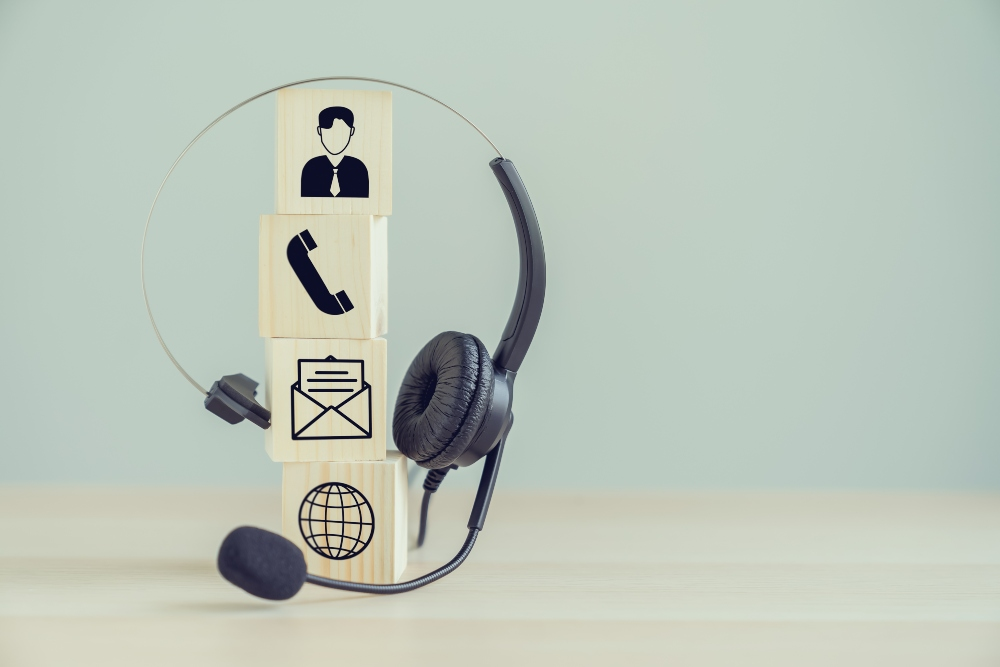 VOIP headset and Icon communication on the wood block.